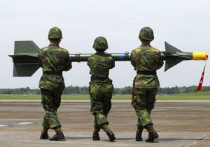 "Soldiers carry a surface-to-air missile named ""Tien-Chien"", or ""Sky Sword"" in Mandarin, onto a launcher during a military exercise at an air force base in Chiayi"