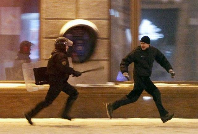 misc-man-running-from-police.jpg