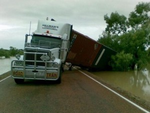misc semi truck runs off the road with flood waters rising