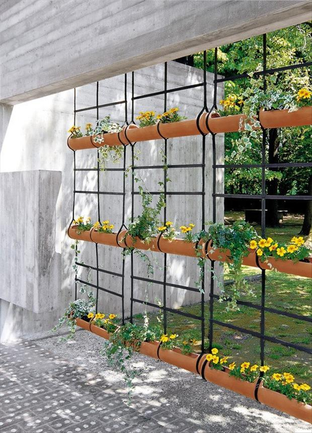 Gardener 39 s dig rain gutters as planters for Hanging patio privacy screen