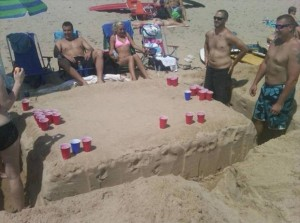 beer pong with red solo cup on the beach funny