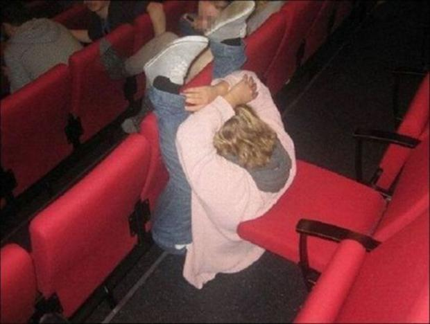 falling out of a movie theater chair