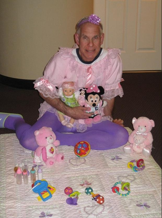 old man playing with toys