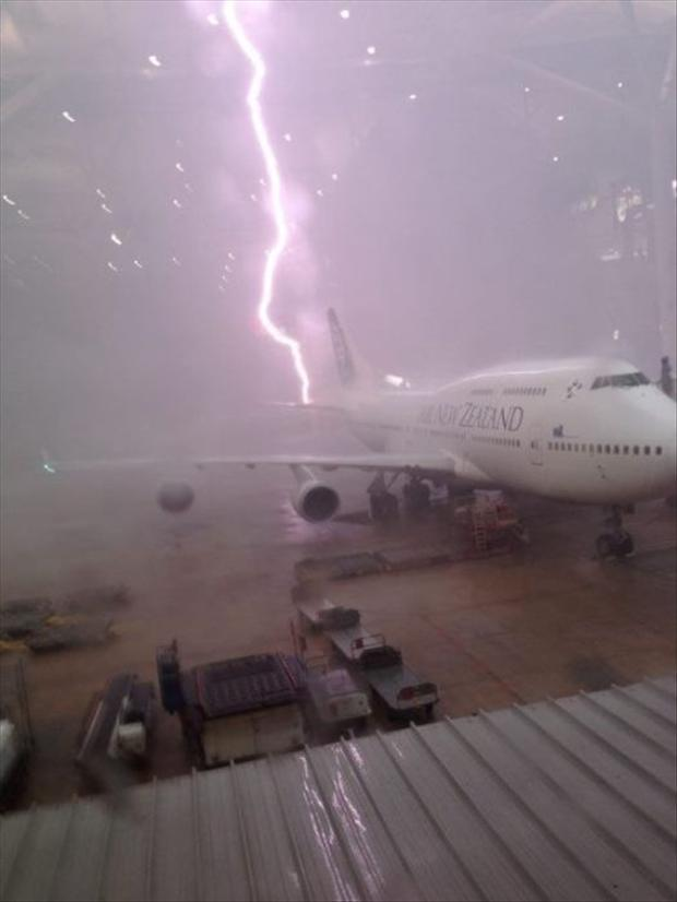 1 perfectly timed pictures, lightning strikes a plane