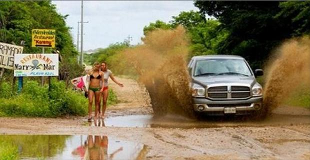 3 truck splashes women walking by a mud puddle, having a bad day