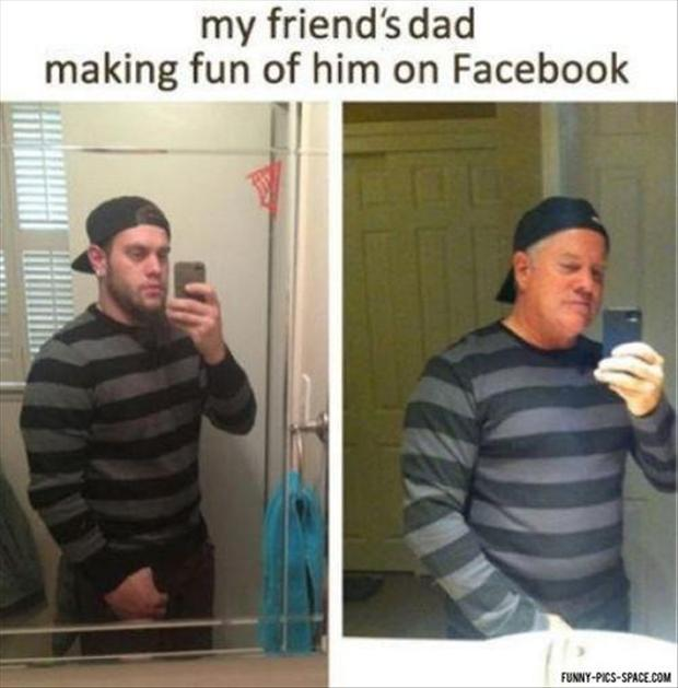 4 dad making fun of son taking a picture of himself in the bathroom mirror