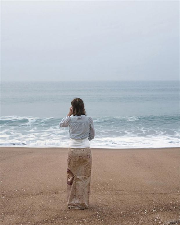 a woman on a beach, optical illusion