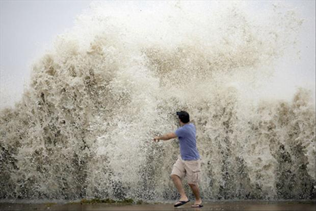big wave splashes on man, having a bad day