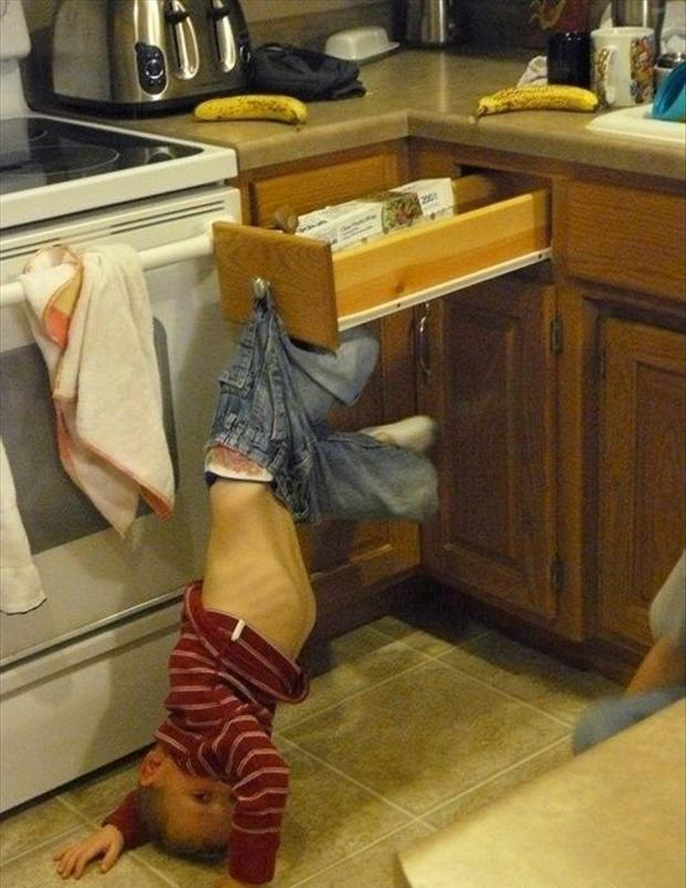 dumb kids, upside down in kitchen