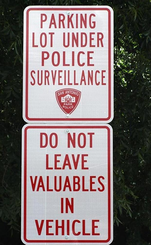 funny signs, parking lot under police watch