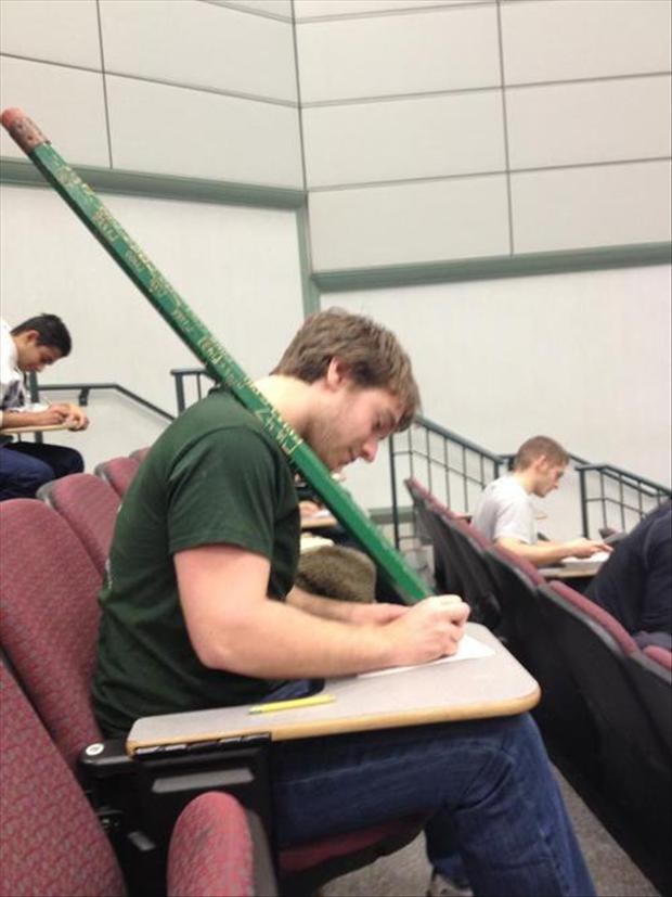 guy uses giant pencil in college