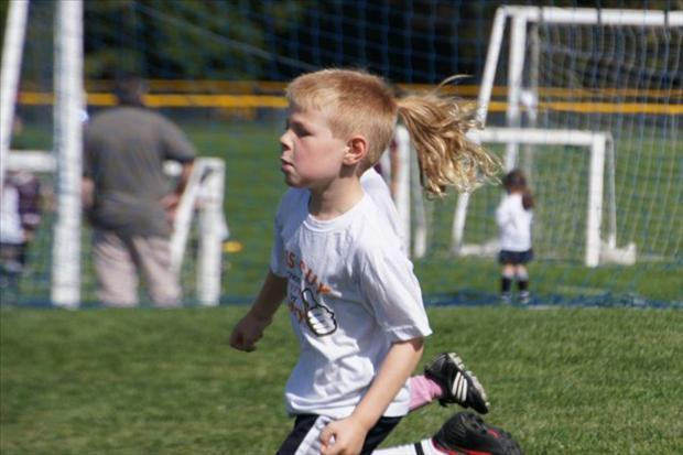 perfectly timed pictures, boy with pony tail