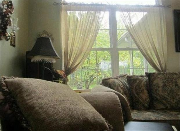 when you see it, face hiding behind couch pillows