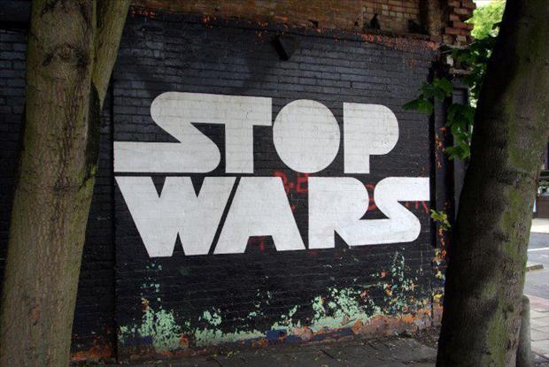 funny stop wars sign