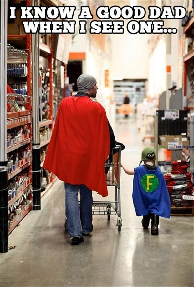 I know a good dad when i see one dad wearing a cape in the store with his son