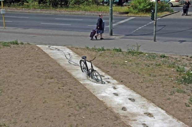 a funny bike stuck in cement