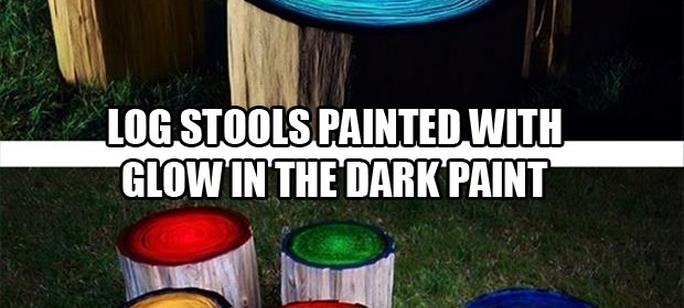 a log stools painted with glow in the dark paint