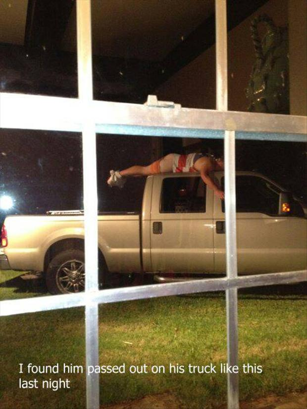 a man passed out drunk on his truck
