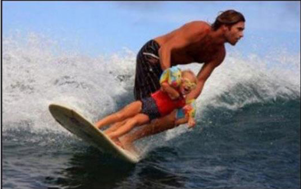 dad surfing with his daughter