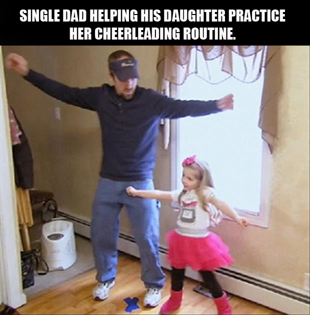 dad teaches his daughter how to cheer