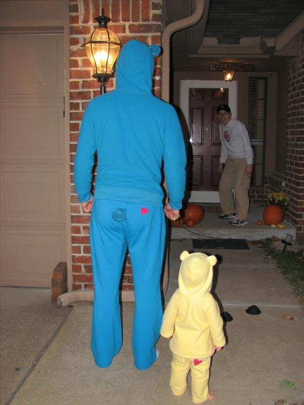 dad trick or treating with their kids