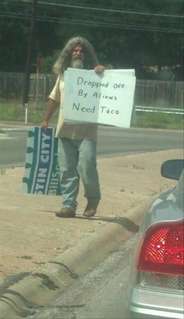funny homelss man signs dropped off by aliens need tacos