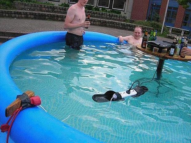 men in pool with electrical outlets