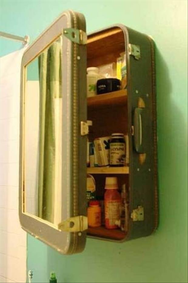 reuse old suit case for a bathroom cabinet