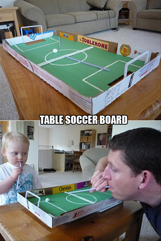 table soccer board made from pizza boxes