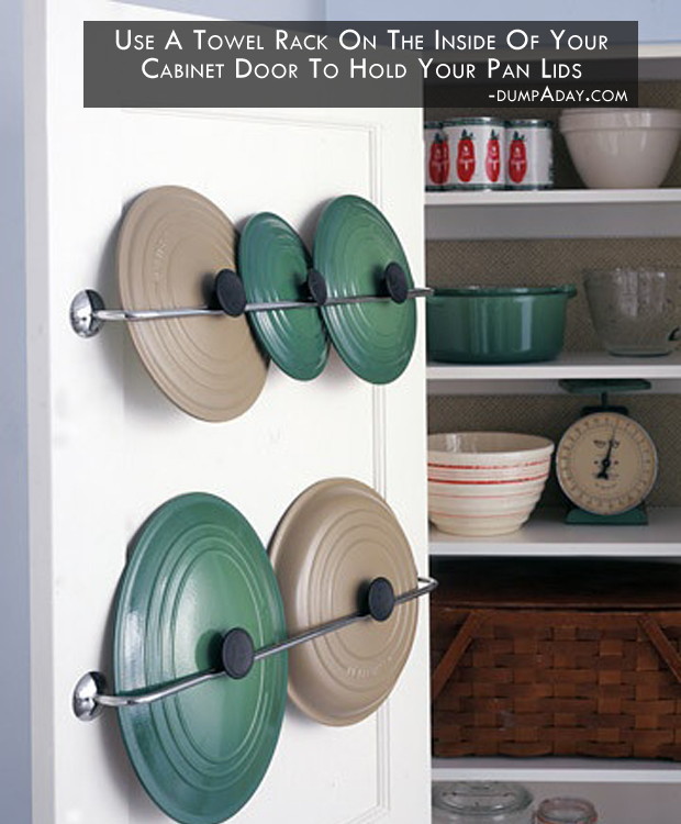 use a towel rack on the inside of your cabinet door to hold your pan lids