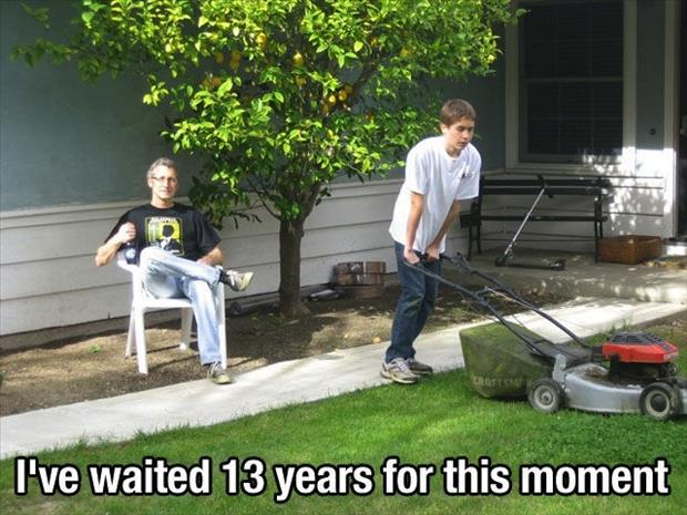 dad watches son mow the lawn