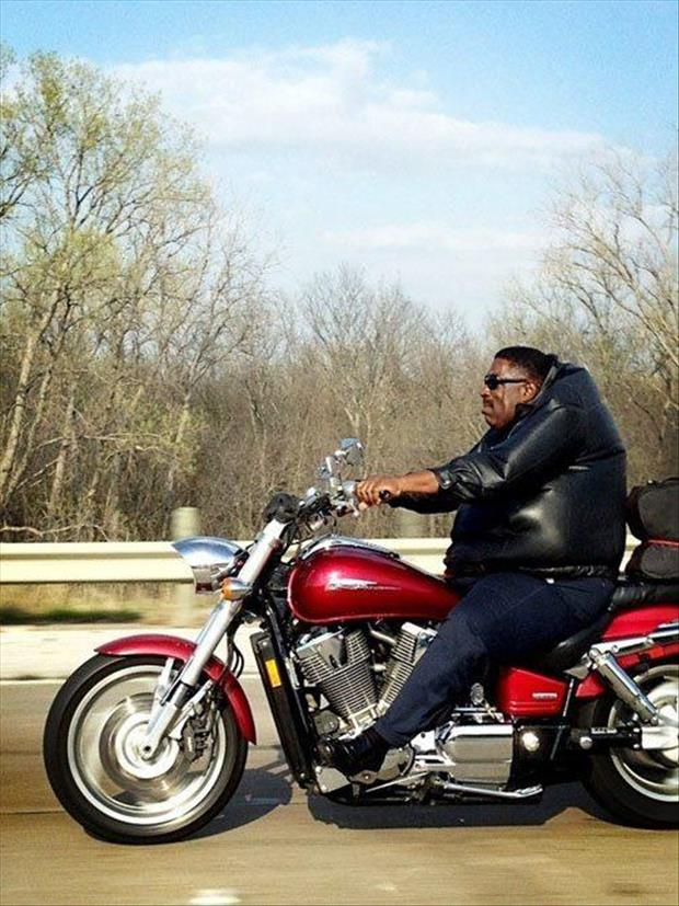 fat man riding a motorcycle