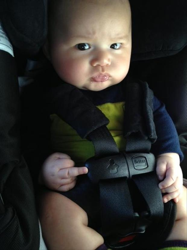 funny baby flips off