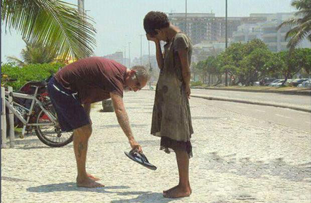 gives homeless man shoes