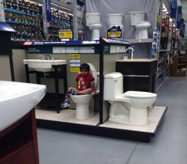 kid going to the bathroom on a test toilet