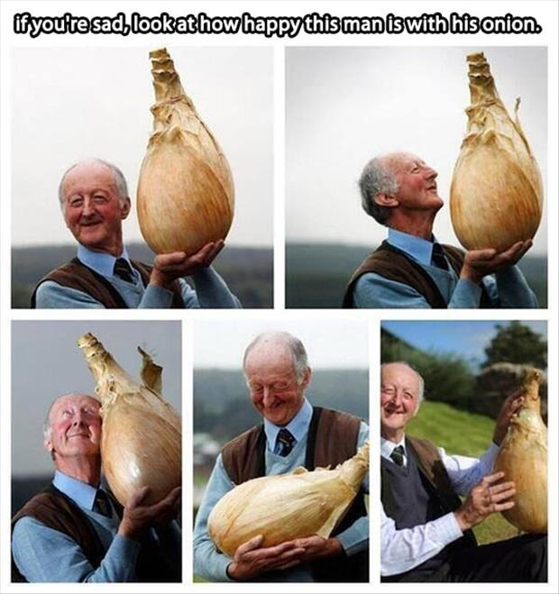 man is happy with his onion