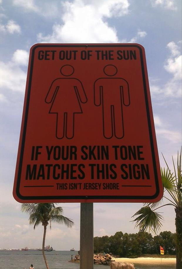 funny tan signs