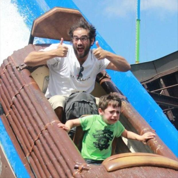 kid is scared on falling log ride