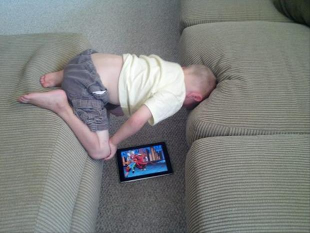 kid watching ipad
