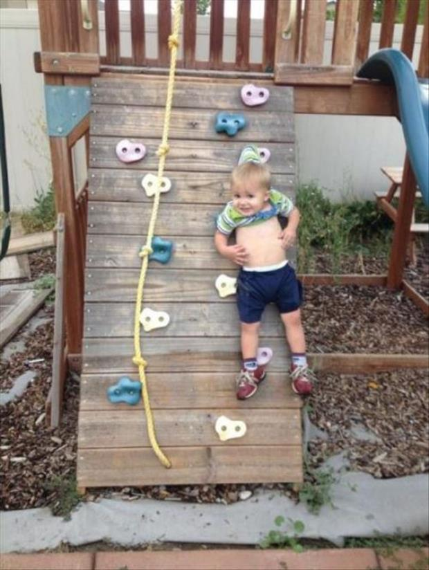 funny kid on a climbing wall