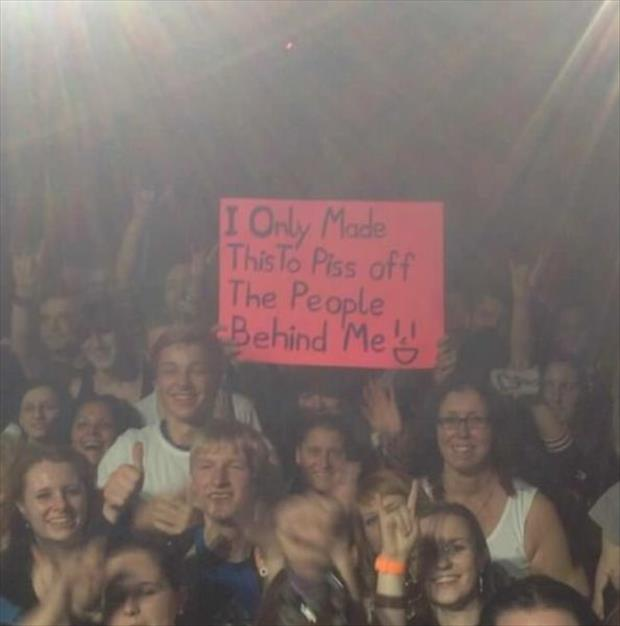 funny signs at a concert
