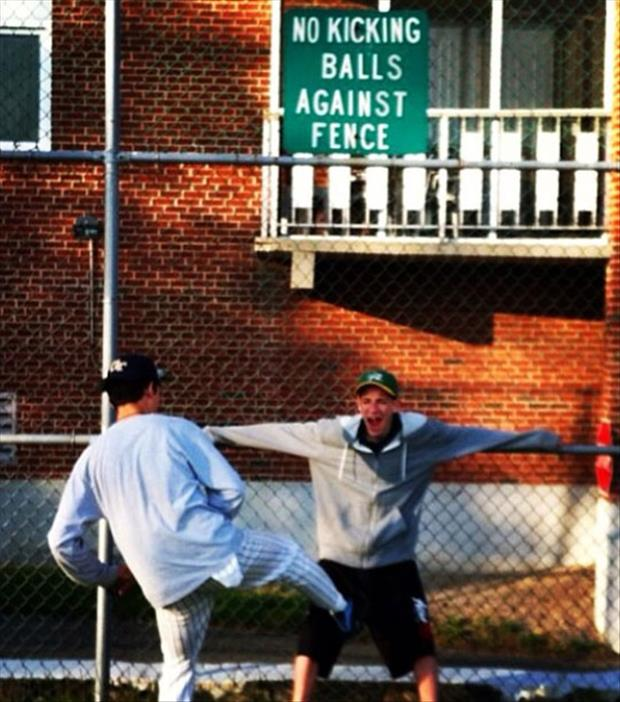kicking balls against the fence