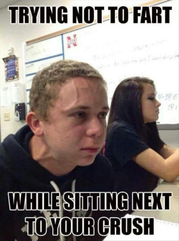 a guy trying not to fart while sitting next to his sweetheart