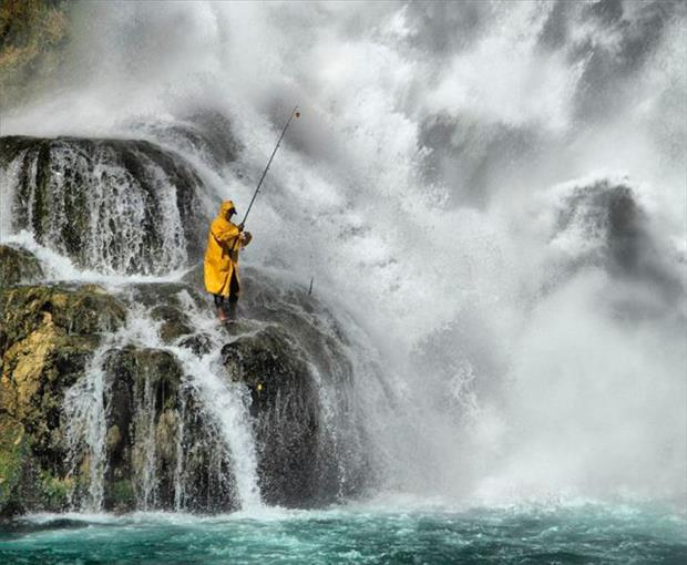 fishing on a waterfall