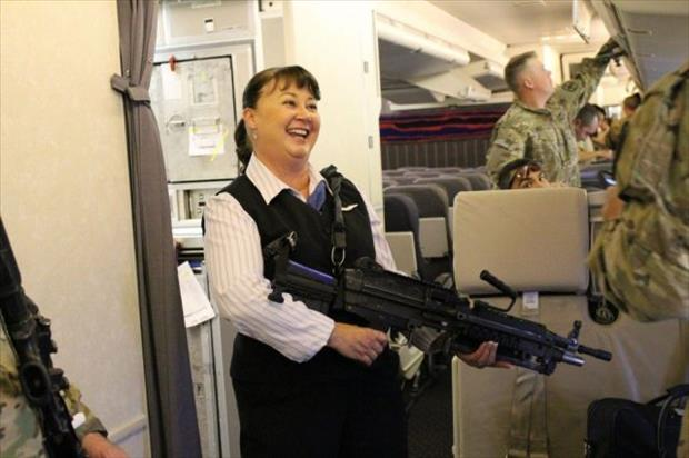 flight attendant with a big gun