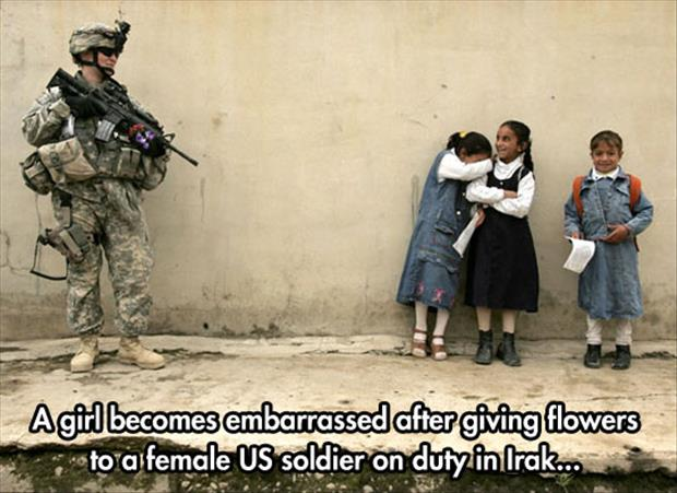 giving flowers to a soldier