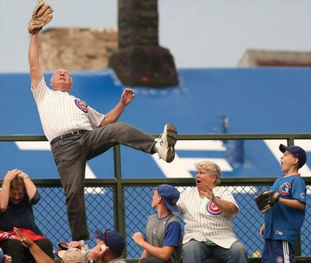old man catching a baseball