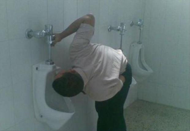 the dude is drinking out of the toilet