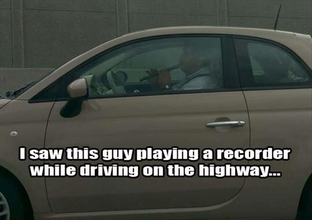 man driving with a recorder