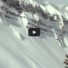 skier does a front flip off a cliff